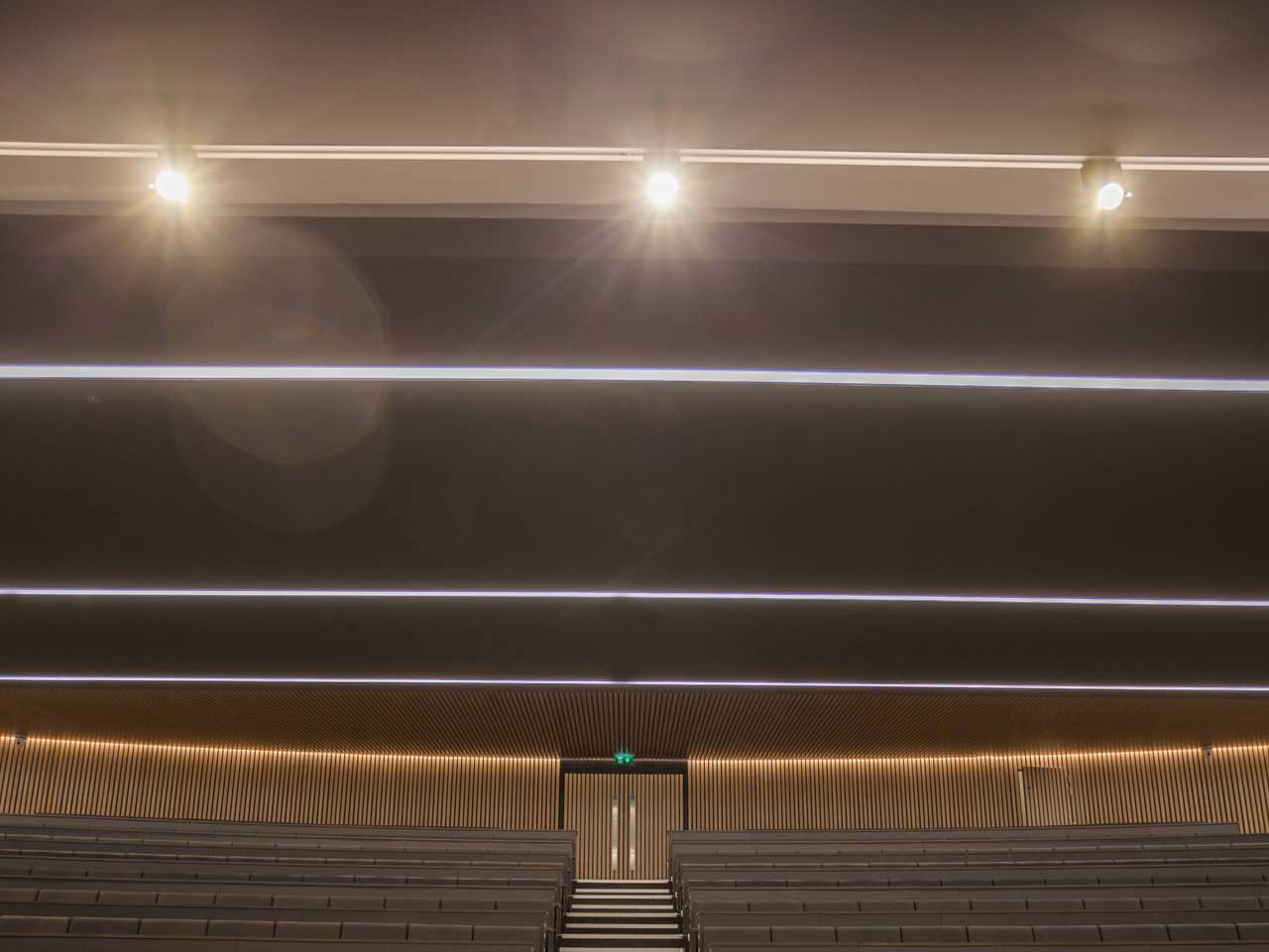 Track spotlights provide addtional focus on the lectern area at the front of the auditorium