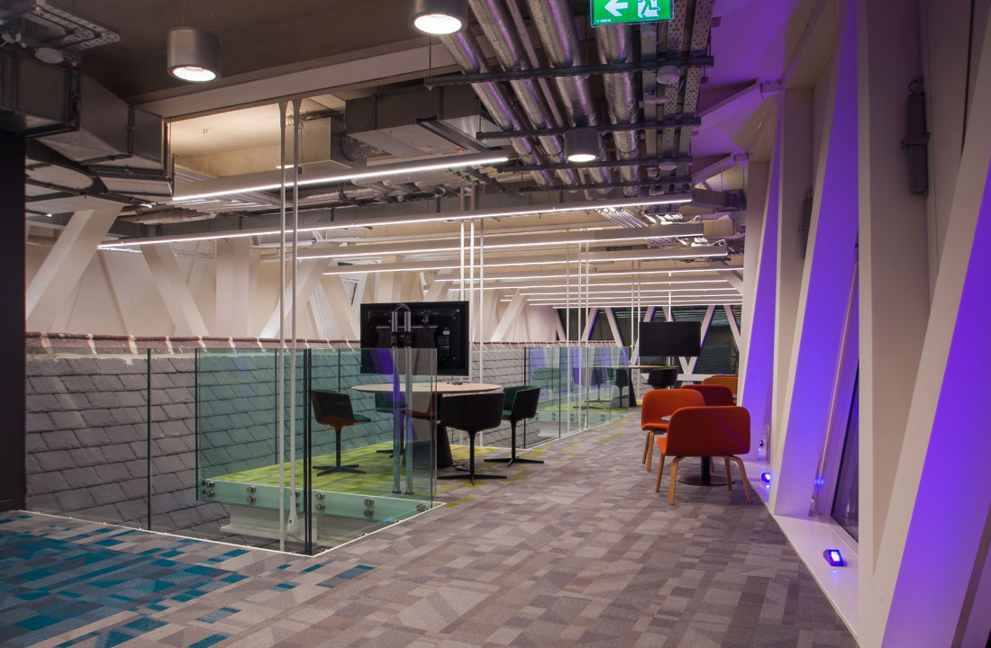 The breakout areas on the mezzanine of VHI HQ are illuminated by Roxo Reba
