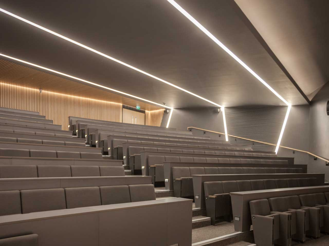 Three Regent Lighting profiles run the width of the auditorium